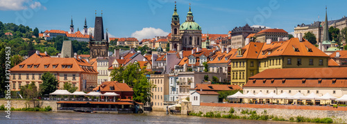 Fototapeta A view of old Prague from the Vltava river on a lovely lazy afternoon