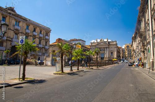 Fotografering Italy, Catania, May 13, 2018: view of Roman Amphitheater ruins and Chiesa San Bi