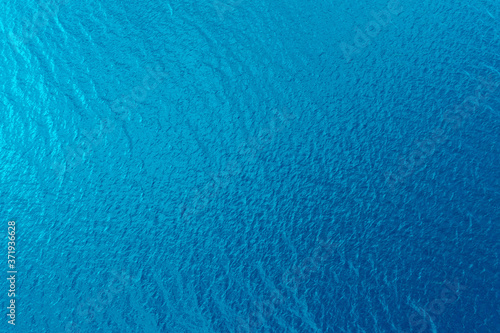 Fototapeta Aerial view of a crystal clear sea water texture. View from above Natural blue background. Blue water reflection. Blue ocean wave. Summer sea. Drone. Top view