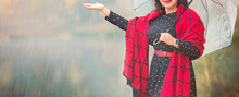 Banner With Attractive Mature Woman In A Stylish Black Dress With Polka Dots And A Red Plaid Scarf With An Umbrella Walking Near The Lake On A Foggy Autumn Day.Woman's Life After 40 Years