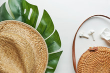 Summer Outfit. Brown Cross Bag, Headphones, Straw Hat. Flat Lay, Top View. Female, Summer Street Style. Women's Frame Of Accessories.