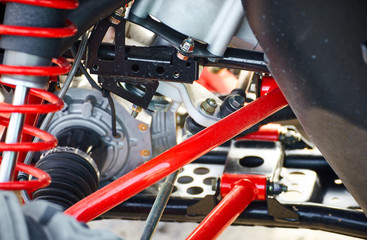 Close-up of suspension elements on an all-wheel drive ATV.