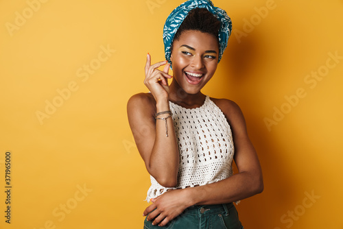 Leinwand Poster Image of funny african american woman snapping her fingers and laughing