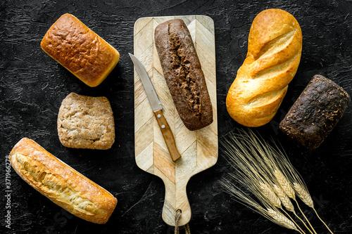 Fotografie, Obraz Loaf of bread on cutting board top-down