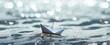 canvas print picture - Freiheit - Papierschiff in den Wellen