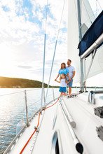 Family Sailing Relaxing During Yacht Ride Standing On Deck, Vertical