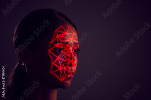 Facial Recognition Technology Concept As Woman Has Red Grid Projected Onto Face Canvas Print