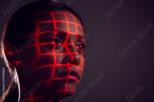 Photo Facial Recognition Technology Concept As Woman Has Red Grid Projected Onto Face