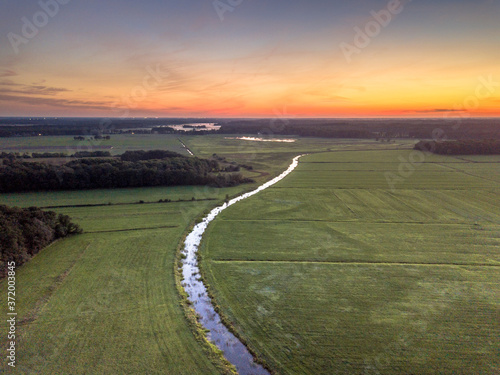 Fotografiet Aerial view of lowland river