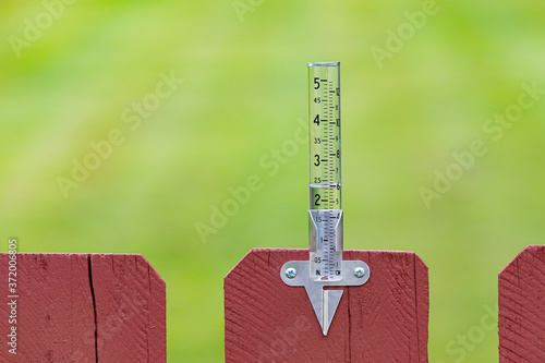 Canvas Print Closeup of rain gauge with rainwater, Concept of weather, rain, drought, flooding and precipitation