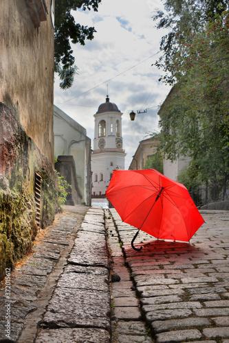 Fototapety, obrazy: Red umbrella on an old european street