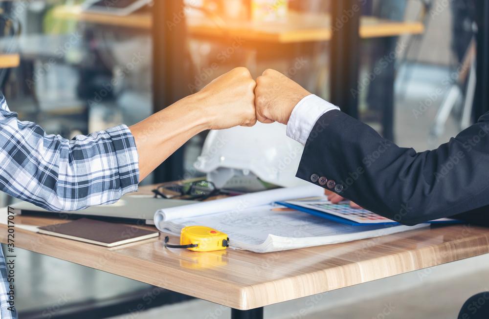 Fototapeta Partner Business Trust Teamwork Partnership. Industry contractor fist bump dealing mission business. Mission team meeting group of People Fist bump Hands together. Business industry trust teamwork