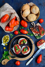 View Of The Table With Sun-dried Tomatoes, Whole Grain Bread, Herbs, Olives. Italian Sandwiches