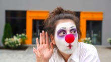 Mime Girl Eavesdropping. Beautiful Clown Woman With Red Nose Wants To Hear Something