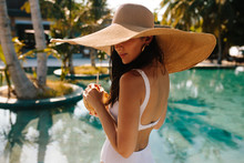 Young Woman Wearing Hat Standi...