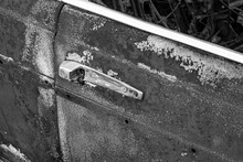 Vintage Cars Abandoned And Rusting Away In Rural  Black And White Photo.
