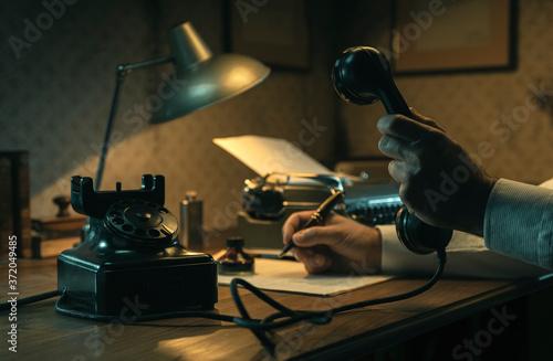 Fototapeta Film noir journalist working at office desk