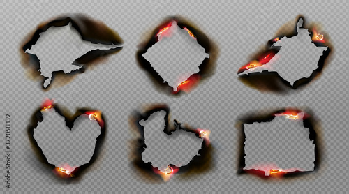 Burnt holes in paper with fire and black ash Fototapet