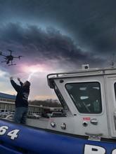 Pilot Grabbing Drone From Police Boat