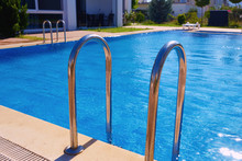Hand Rails Of Swimming Pool. Metal Entry Ladder Of Swimming Pool