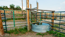 Stock Tank And Metal Fence Panels And Wooden Fencing In The Animal Corral On A Working Ranch Near Denver