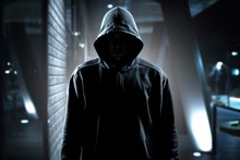 Thief In Black Clothes On Room Background