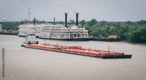 Photo Barge in river, industrial and cargo transportation