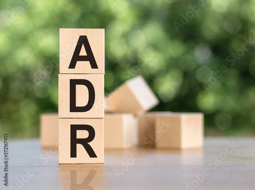 Letter block in word ADR (Abbreviation of adverse drug reaction) on wood backgro Wallpaper Mural
