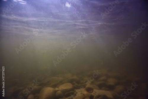 Photo stones at the bottom underwater landscape, abstract blurred under water backgrou