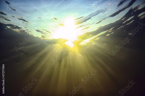 rays of light underwater fresh lake, abstract background nature landscape sun wa Fototapet