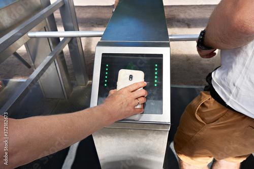Cuadros en Lienzo Pass through turnstiles with smartphone