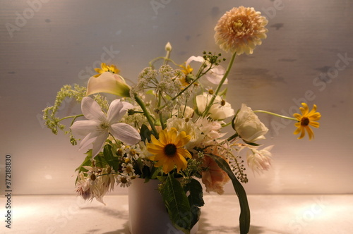 Fototapeta fragrant yellow flowers in a vase