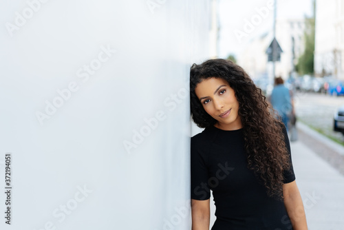 Fototapeta Quiet introvert young woman with a gentle smile