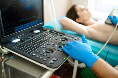 Fototapeta A mammologist makes breast ultrasound scanning obraz