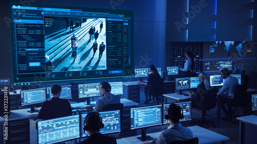 Team of Professional Cyber Security Data Science Engineers Work on Surveillance Tracking Shot of People Walking on City Streets Canvas Print