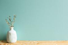 Vase Of Eucalyptus Leaves On W...