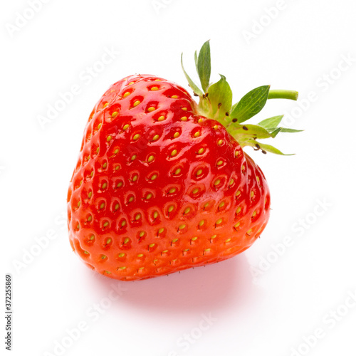Obraz na plátně Fresh strawberries closeup on a white background