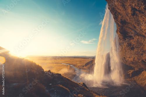 Seljalandsfoss waterfall at sunset, Iceland Fototapet