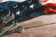USA Labor Day Concept, Top View Flat Lay Of Different Kinds Wrenches With American Flag On Wood Table. First Monday In September, Creation Of Labor Movement And Dedicated To Social Of American Worker