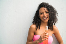 Young Afro Woman Drinking Beer.