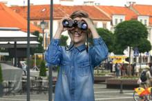 Boy Observing City Using Binoc...