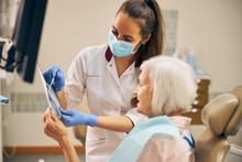 Beautiful Woman Checking Teeth...