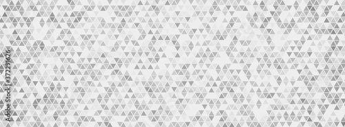 Fotografiet Triangular mosaic texture. Abstract polygonal background.