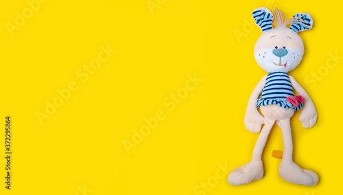 Soft toy hare rabbit on yellow background, top view Fototapet