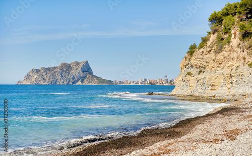 Cuadros en Lienzo Cala Baladrar empty pebble stone beach. Costa Blanca, Spain