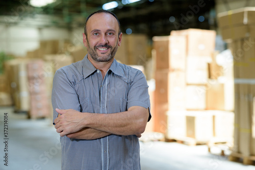 Leinwand Poster smiling man in a warehouse