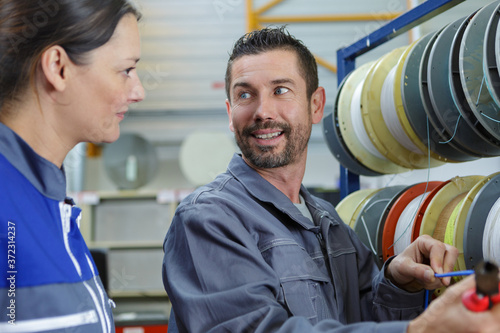 Photo electricians in the agency talking
