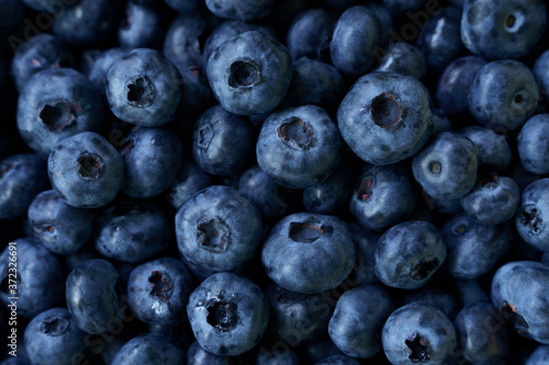 Foto Flat lay raw blueberry natural pattern . High quality photo