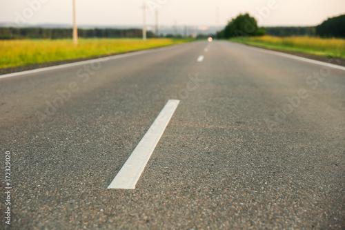 Fototapeta road markings on asphalt close up