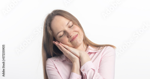 Tired girl with closed eyes expressing boredom and pretending asleep Canvas Print
